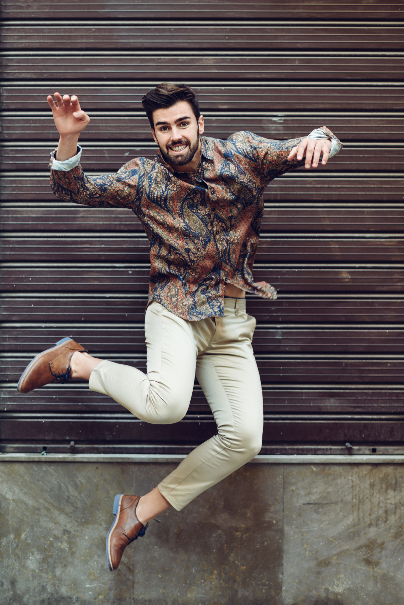 husky smith direct to consumer london uk shoes boots Young bearded man jumping in urban background with open arms huskandsmith